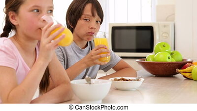 Brother and sister having cereal together