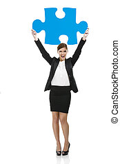 Businesswoman with a puzzle piece - Beautiful young business...