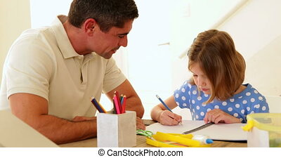 Father and daughter drawing together at home in living room...