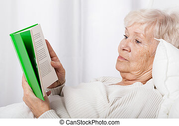 Elderly lady reading book - Elderly lady during reading book...