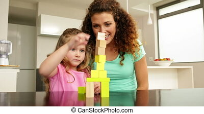 Mother and daughter playing with blocks - Mother and...
