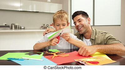 Happy father and son doing crafts