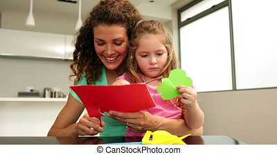 Cute mother and daughter doing crafts