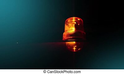 Flashing beacon Orange flashing and rotating light on top of...