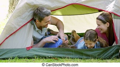 Funny family in their tent on a camping trip on a sunny day...