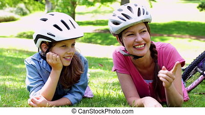 Mother and daughter resting on their bike ride - Mother and...