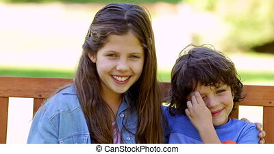 Brother and sister laughing together