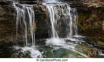 Little Waterfall Loop - Water pours over a small limestone...