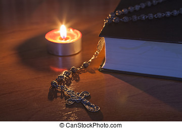 Rosary beads and a holy bible