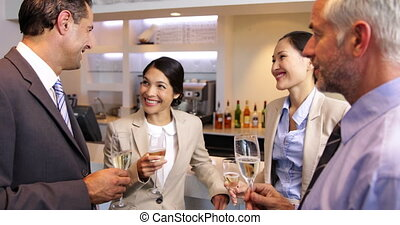 Business associates celebrating after work and drinking wine...