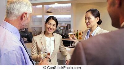 Business partners celebrating after work - Business partners...