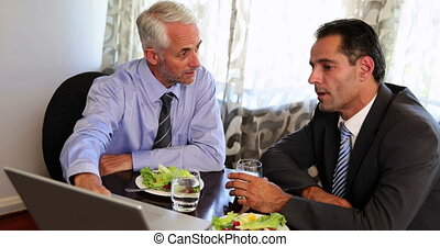 Businessmen having a working lunch at a restaurant