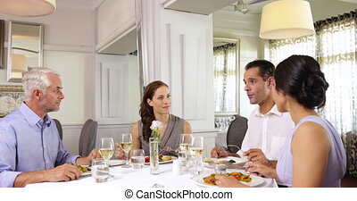 Waiter attending to a table of friends - Waiter attending to...