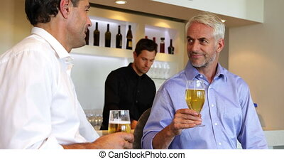 Male friends enjoying a beer togeth