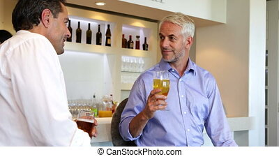 Male friends enjoying a beer together