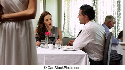Woman shouting at her chauvinist husband at a restaurant