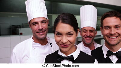 Cheerful restaurant staff smiling at camera in a commercial...