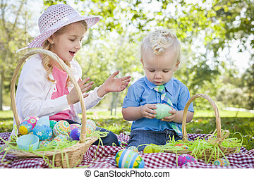 Cute Young Brother and Sister Enjoying Their Easter Eggs...