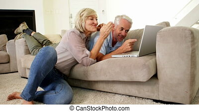 Happy couple using laptop together