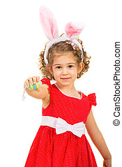 Small girl with bunny ears giving Easter egg isolated on...