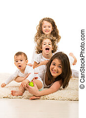 Mother and kids having fun home - Mother and their three...