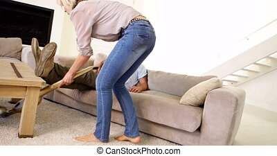 Woman hoovering the carpet