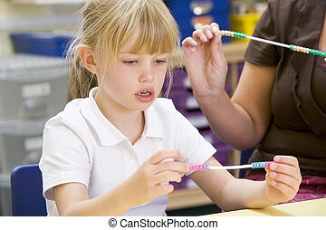 A schoolgirl in a primary class