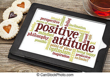 positive attitude word cloud on a digital tablet with a cup...