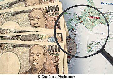 Japan tourist map, with Japanese Yen (Travel concept)