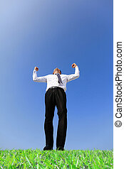 Excited business man arise arm in the air cheering and...