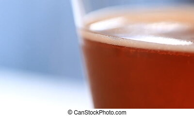 macro beer - A macro shot of the side of a beer filled glass...