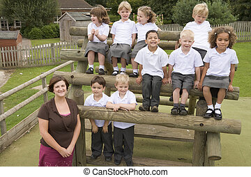 Young children and their teacher posing for a class photo