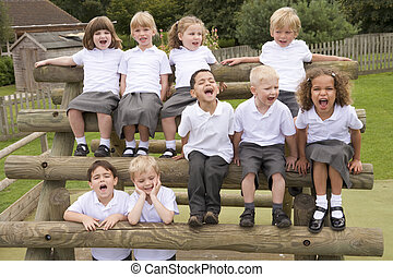 Young children sitting on benches and yelling