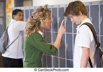 A teacher telling a student off