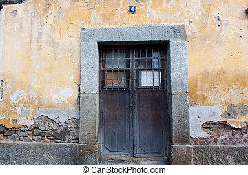 Door and wall of ruined house in Antigua Guatemala
