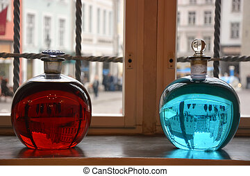 Two alchemical bottles with red and blue liquid in Tallinn...