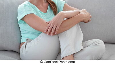 Pretty woman relaxing on sofa at home in the living room