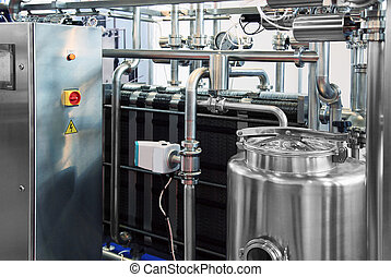 Milk Industry - Dairy factory with milk pasteurization tank...