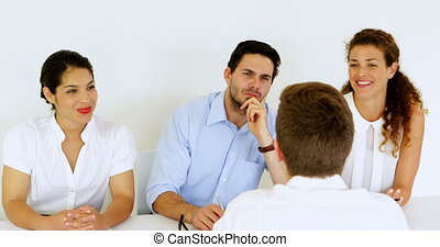 Interview panel giving thumbs down to job applicant