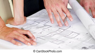 Architects going over blueprints in the office