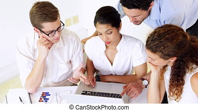 Business people having a serious meeting at desk in the...