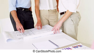 Team going over building plans with