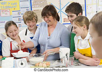 Schoolchildren and teacher at school in a cooking class