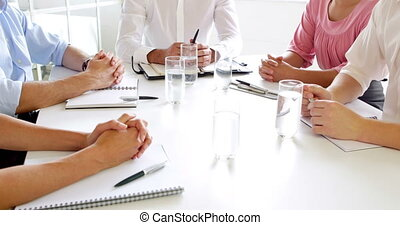 Businesswomen shaking hands at meeting in the office