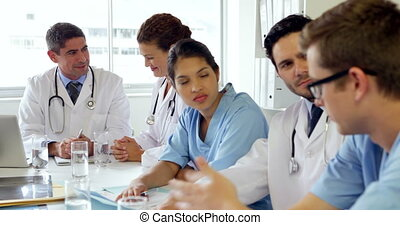 Medical team having a meeting in the board room at the...