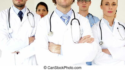 Medical team looking at the camera with arms crossed at the...