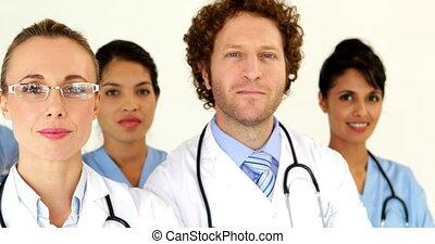 Medical team looking at the camera at the hospital