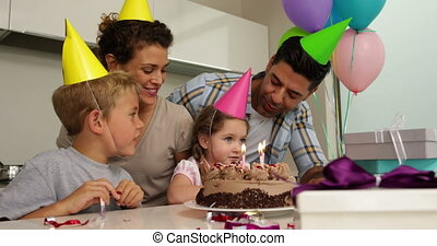 Family celebrating a birthday toget - Family celebrating a...