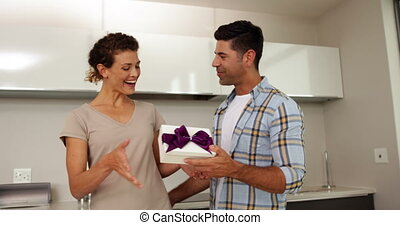 Man giving his partner a gift