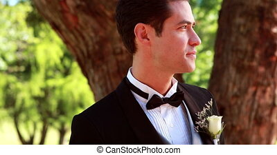 Nervous groom waiting for his bride on a sunny day
